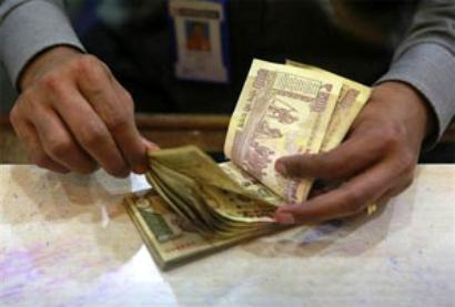 Rupee ends slightly weaker