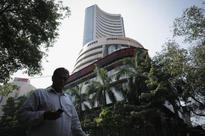 Sensex hits record high as BJP wins state polls