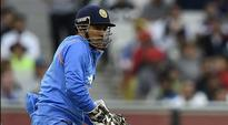 Cool-mask lifts as Dhoni looks for answers