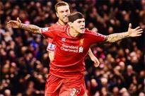 Bloodied Skrtel earns Liverpool point against Arsenal