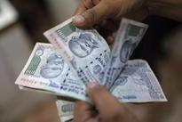 Rupee drops 27 paise to end at 67.35